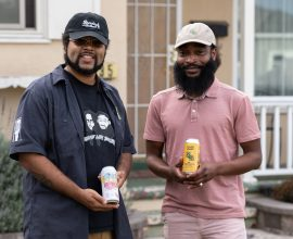 """RiSean """"Bookie"""" Tinsley and Denzel Jackson hold the beers they have created in collaboration with local breweries."""