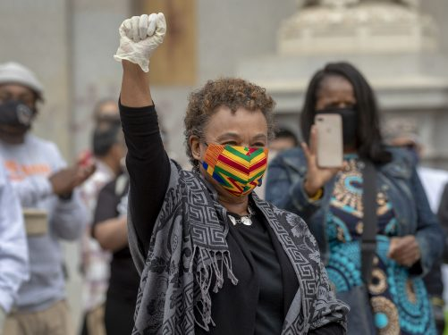 Congresswoman Barbara Lee holds her fist up at a solidarity George Floyd protest event in Oakland.